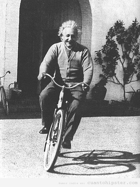 Albert  Einstein con una chaqueta cardigan hipster y una bicicleta de paseo