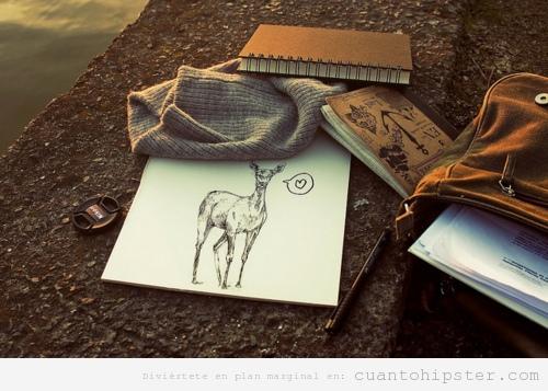Bodegón hipster con cuaderno, mochila, dibujo ciervo