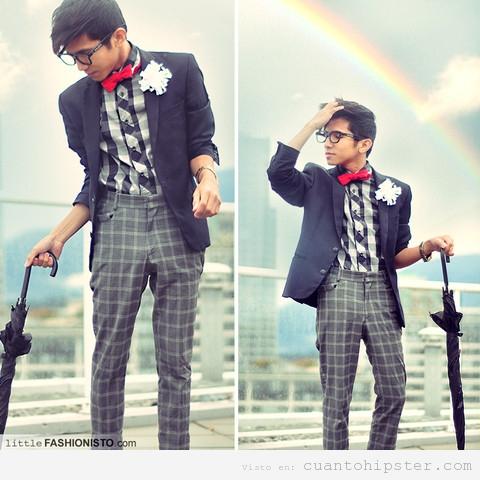 Chico asiático con ropa hipster, pantalones y camisa a cuadros, pajarita roja y gafas de pasta