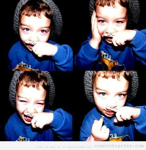 Niño hipster con bigote pintado en el dedo