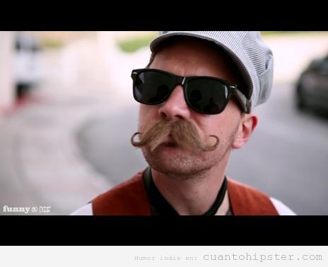 Foto graciosa de un hombre con look hipster y un gran bigote