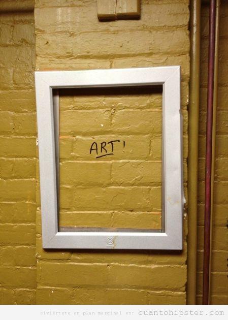 Marco en una pared de ladrillos con la palabra Art escrita en la pared