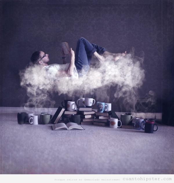 Foto bonita de un chico leyendo sobre una nube de vapor de tazas de té y café