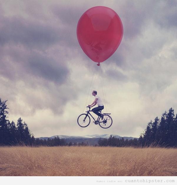 Fotografía indie y hipster bonita, chico en bicicleta volando con globo
