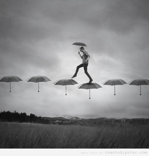 Imagen bonita de un hombre caminando sobre paraguas
