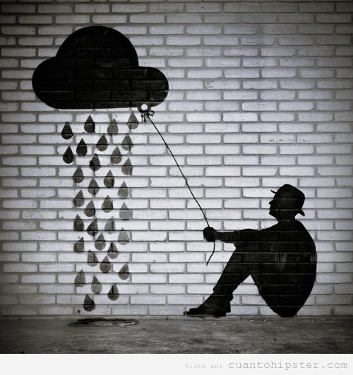 Dibujo bonito en una pared de ladrillos, un homrbe sostiene una nube d elluvia